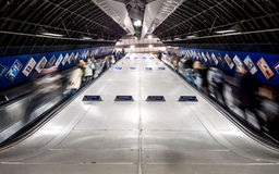 Lonon Underground escalators with commuters - low angle Royalty Free Stock Images