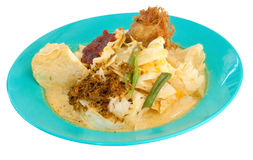 Lontong. Malay style rice cakes and vegetables in curry gravy Stock Photo