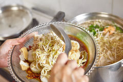Lontong mie. In Indonesian for its famous traditional food, or in English maybe spelled rice cake and noodle in vegetable soup Royalty Free Stock Photo