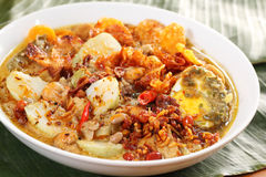 Lontong Sayur, Indonesian culinary dish. Lontong Sayur, an Indonesian specialty culinary dish consist of rice cake, bean curd, egg, peanut, and vegetable in Stock Image