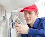 Loodgieter in eenvormig Stock Afbeeldingen