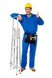 Loodgieter het stellen vol vertrouwen met omhoog duimen Stock Fotografie