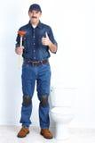 Loodgieter met een duiker Stock Foto's