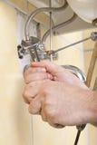 Loodgieter op het werk stock foto