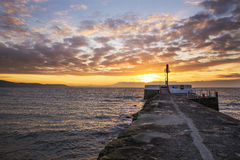 Looe beach and pier at sunrise . Royalty Free Stock Photo