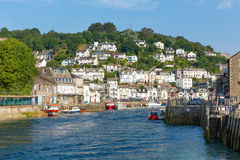 Looe Cornwall England Boats And Hillside And Blue Sea And Sky Stock Images