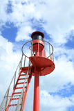 Looe Cornwall Lighthouse against blue sky and clouds Stock Photo