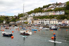 LOOE, CORNWALL, UK – MAY 17, 2015: Looe fishing port with paddle surf practice Stock Images