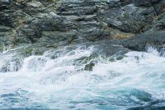 Waves crashing on rocks Stock Photos