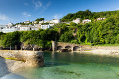 Looe Harbour Wall Cornwall England With Blue Green Sea Royalty Free Stock Image