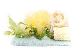 Loofah, bamboo and towels Stock Image