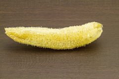 Loofah (Luffa) - natural fiber for body scrubbing  on black wood Stock Images