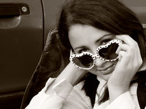 The look. Close up of a beautiful looking over the top of her Super Model sunglasses Stock Image