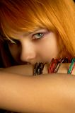 Look. Dark portrait of lovely redhead Stock Images
