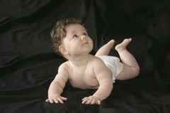Look at that!. Baby girl looking up royalty free stock photo