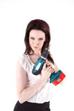 The look. Young brunette posing with drill Royalty Free Stock Images