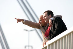 Look. Two businessmen standing on bridge Royalty Free Stock Photo
