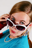 The look. Closeup of teenage girl looking over her sun glasses Stock Images