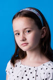 Look. The girl of ten years on blue background royalty free stock photos