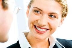 Look. Portrait of young smiling  woman gazing at business man Royalty Free Stock Photography