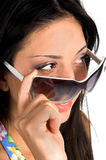 The Look. Close up of a beautiful latina looking over the top of her Super Model sunglasses royalty free stock images