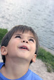 Look. Child looking up stock photo