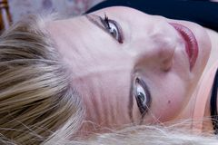 Look. Blond woman face with green eyes Stock Images
