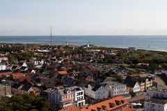 A look from above the lighthouse over the northern sea island borkum with the houses and the sea royalty free stock photo