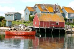 The old fishing village by the ocean. Look at all the great colors in this little village stock photo
