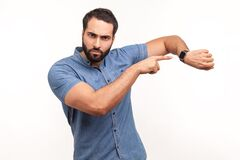 Free Look At Time! Impatient Bossy Man With Beard Pointing Finger At Wrist Watch And Looking Annoyed And Displeased, Showing Clock To Stock Images - 207867974