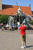 """Look away for a photo. Summer of 2006; location: middle of berlin / fountain of neptune; funny situation: the photographer said:""""smiiile!"""" and all person stock photo"""
