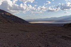 A look at the Badwater Salt Flats. With the sun breaking through the clouds stock photography