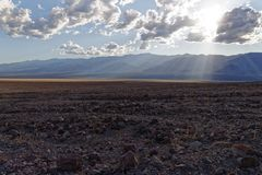 A look at the Badwater Salt Flats. With the sun breaking through the clouds stock photo