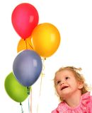 Look on ballons. Cute little girl with balloons Royalty Free Stock Photos