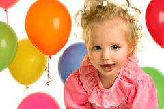 Look on ballons. Cute little girl with balloons Stock Image