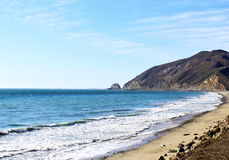 A look at the beach. Looking at the beach waves with a beautiful look at Point Mugu rock Stock Image