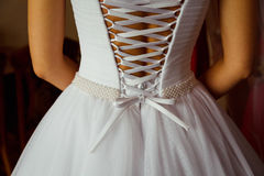 Look from behind at little bow in the end of the corset Stock Photos