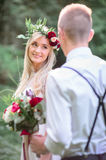 Look from behind man`s back in braces at gorgeous bride Stock Image