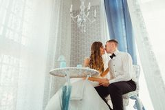 Look from below at beautiful wedding couple kissing stock photos