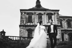 A look from below on a wedding couple standing in the front of a. N old castle Stock Images