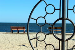 Look through and beyond. A jungle gym in a sandy playground overlooking the ocean Royalty Free Stock Photography