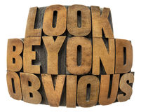 Look beyond obvious in wood type. Isolated text in fisheye lens perspective in vintage letterpress wood type Stock Photography
