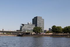 The look at a big building at the river bank of cologne watched from the rhine sight during the sightseeing boat trip stock photo
