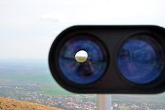 Look through binoculars to see the landscape Royalty Free Stock Photo