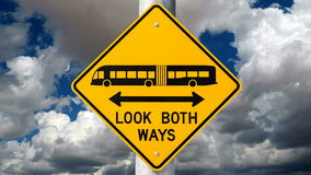 Look Both Ways Bus Warning Sign Time Lapse. Look both ways bus and tram warning sign with time lapse clouds stock video footage