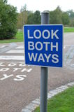 Look both ways. Pedestrian crossing with look both ways sign Stock Photography