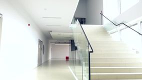 Look at the bright modern building interior stairs stock video footage