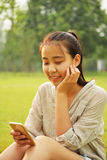 Look at cell phone girl Royalty Free Stock Images