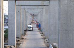 Look Through the Cement Pillars With Long Distance Construction. royalty free stock images