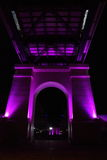 Look through centre of bridge columns by night Stock Photography